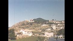 Vintage 16mm film, 1954 Portugal Cascais hillside windmills Stock Footage