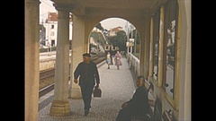 Vintage 16mm film, 1954 Portgual Estoril train station, train arriving Stock Footage