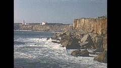 Vintage 16mm film, 1954 Portugal Cascais big waves crashing on rocky coast Stock Footage