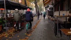 Street in the central area of Amsterdam. Early morning. Peoples drive to work Stock Footage