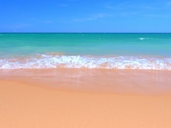 Ocean coast beach with blue sky above sea horizon and waves roll on white sand Stock Footage