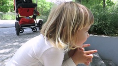 Little child sitting and singing Stock Footage