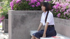 Asia thai high school student uniform beautiful girl read a book Stock Footage