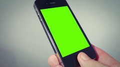 Hand holding smartphone with green screen Stock Footage
