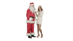 Christmas woman with santa claus dancing on white background Stock Footage