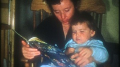Mom reads her daughter a story before bedtime, 3827 vintage film home movie Stock Footage