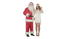 Beautiful happy woman dancing with Santa Claus on white background Stock Footage