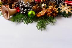 Christmas decoration with golden pine cones and handmade straw ornaments Stock Photos