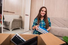 Young woman packing personal belongings Stock Photos