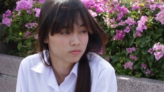 Portrait of thai high school student uniform teen beautiful girl using her phone Stock Footage