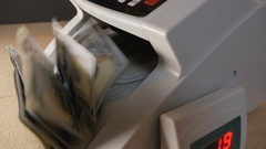 Money counting machine counts 100 dollar bills Stock Footage