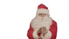 Santa Claus calling with a mobile phone on white background Stock Footage