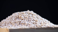 Rotating sesame seed in wooden bowl Stock Footage