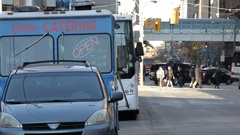 Catering Truck Parked on Busy Downtown Street at Rush Hour Stock Footage