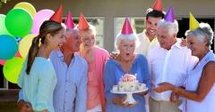 Doctors and senior citizen celebrating birthday Stock Footage