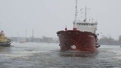 Oil tanker moving through the ice on frozen river, shipping, boat, 4k Stock Footage
