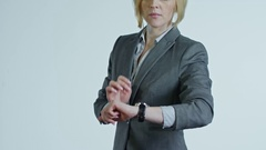 Businesswoman Using Smart Watches Stock Footage