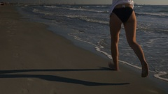 Female runner jogging on the seaside doing outdoor workout Stock Footage
