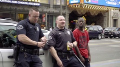 LAPD police officers hanging out with Welven Da Great on Hollywood Boulevard LA Stock Footage