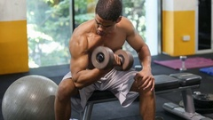 Man exercise with dumbbells in gym Stock Footage