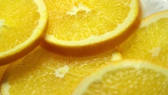 Sliced oranges with leaves close-up. Dolly pan Stock Footage