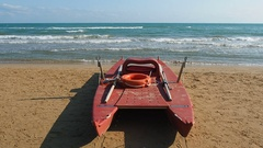 Safety twin-hulled rowboat on the beach Stock Footage