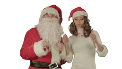 Santa claus dance with Attractive Christmas lady on white background Stock Footage