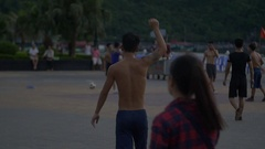 People playing soccer on the street Stock Footage