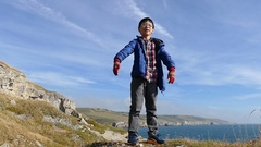 Boy feel happy on the hill Stock Footage