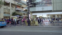 Driving down crowded Hollywood Boulevard people and tourists walking LA Stock Footage