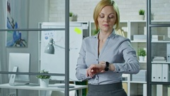 Woman Using Business Model of Smartwatches Stock Footage