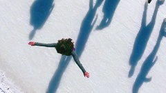 Aerial view of ice skating woman outdoor, ice rink Medeo Stock Footage