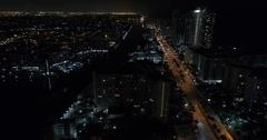 Hallandale Ocean Drive night aerial video Stock Footage