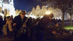 PRAGUE, CZECH REPUBLIC - DECEMBER 3, 2016. Senior saxophone musician on Old town Stock Footage