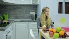 Pretty blond girl eating and drinking healthy food at home, health care concept Stock Footage