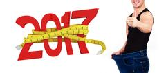 Composite image of digitally generated image of new year with tape measure Stock Photos