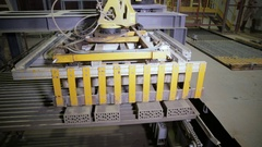 Automated machinery equipment. Robotic arm assembling products, bricks Stock Footage