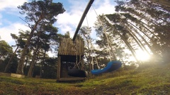 Empty swing in the Forest Stock Footage