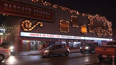 Iconic Honest Eds department store neon signs flashing at night Stock Footage