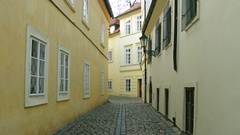 4K steadicam shot of very narrow cobblestone paved empty street. Old european Stock Footage