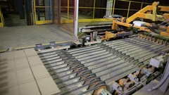 Industrial robot conveyor working at a factory, assembling goods, bricks Stock Footage