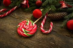 Christmas border with fir tree branches, cones, christmas decorations and c.. Stock Photos