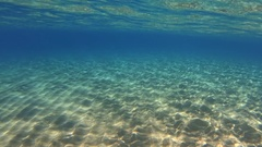 Moving along over sandy ground of the ocean with reflections Stock Footage