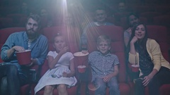 Family in Movie Theater Stock Footage