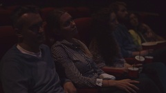 Couple Sitting In a Movie Theater Stock Footage