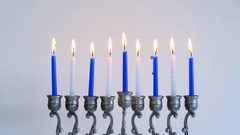 Time lapse - Silver Menorah with burning Hanukkah candles Stock Footage