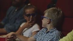Kids Laughing in Movie Theatre Stock Footage