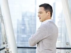 Business person thinking by the windows Stock Photos