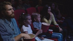 Family Weekend in Movie Theater Stock Footage
