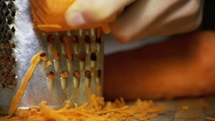 Carrots on a Grater Rubbed on the Home Kitchen. Slow Motion Stock Footage
